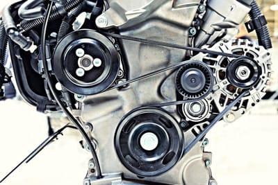 Serpentine belt winding through engine workings