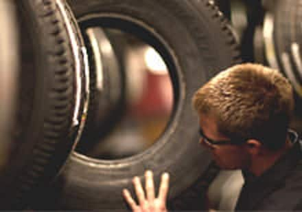 Tire inspection at Firestone Complete Auto Care