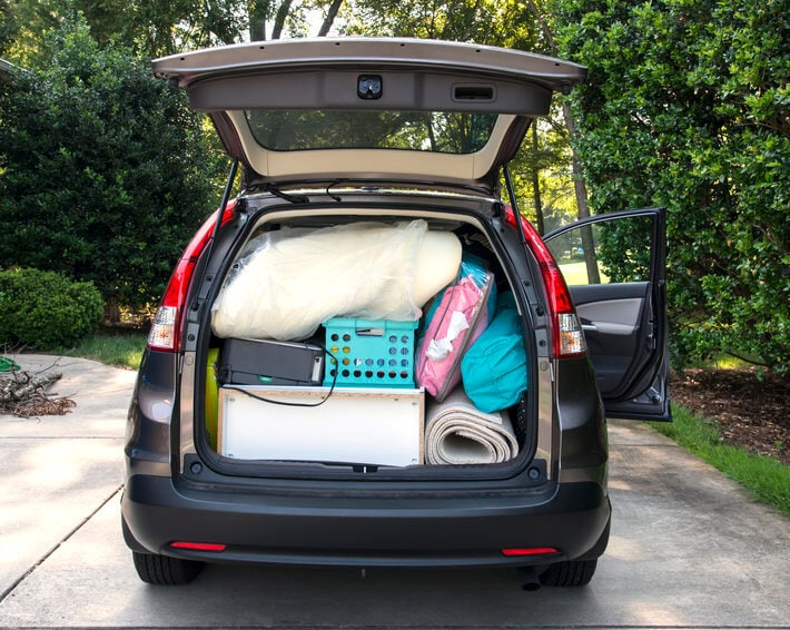 Hatchback trunk of car open, showing car packed and ready for college