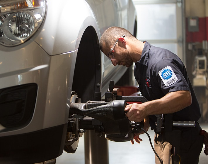 Professional technician repairing vehicle at Firestone Complete Auto Care
