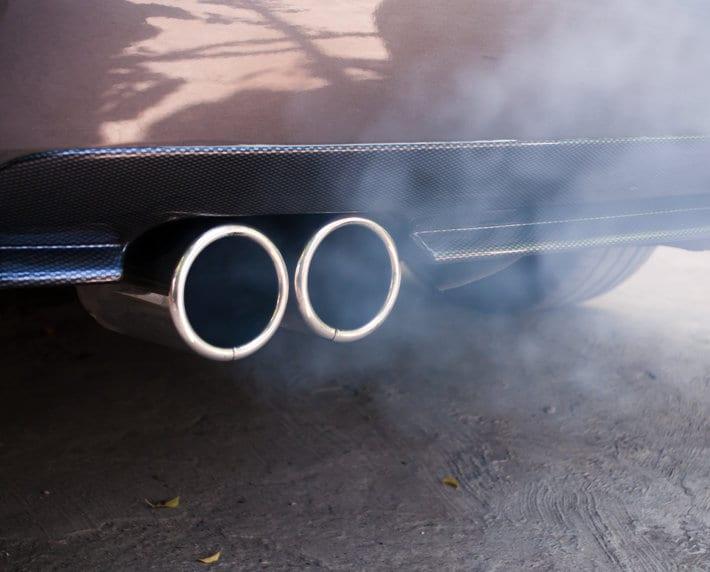 Car exhaust pipe expelling smoke