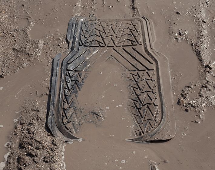 Floor mat of car in mud and water