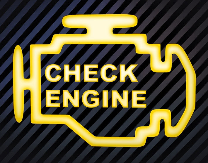 Yellow and black close up of car's check engine light on