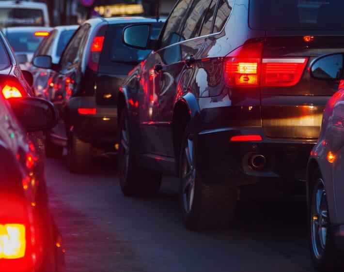 Line of cars, brake lights in traffic