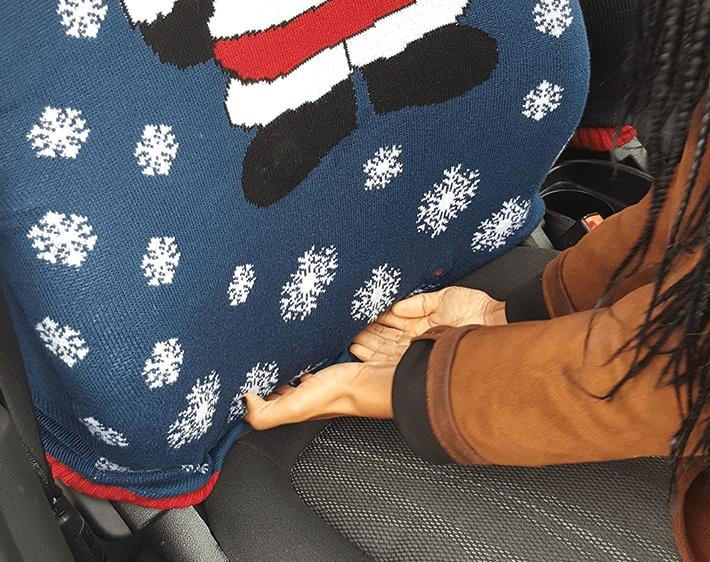Tucking sweater into cushion of car seat