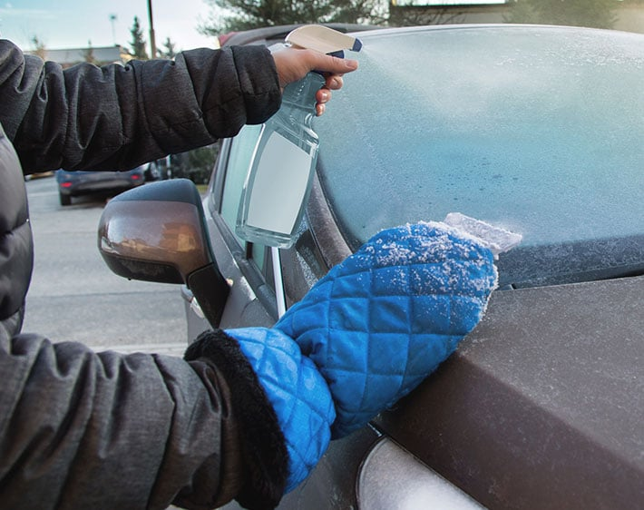 Hand spraying solution to defrost windshield wipers