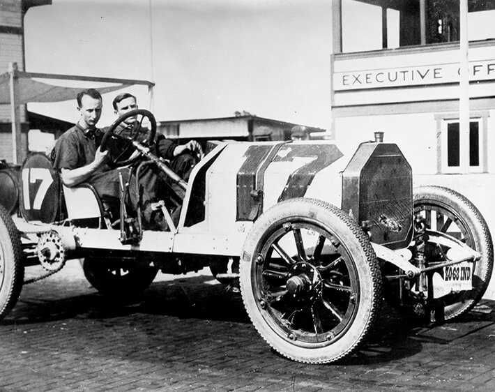 Early Indianapolis 500 race car with thin tires