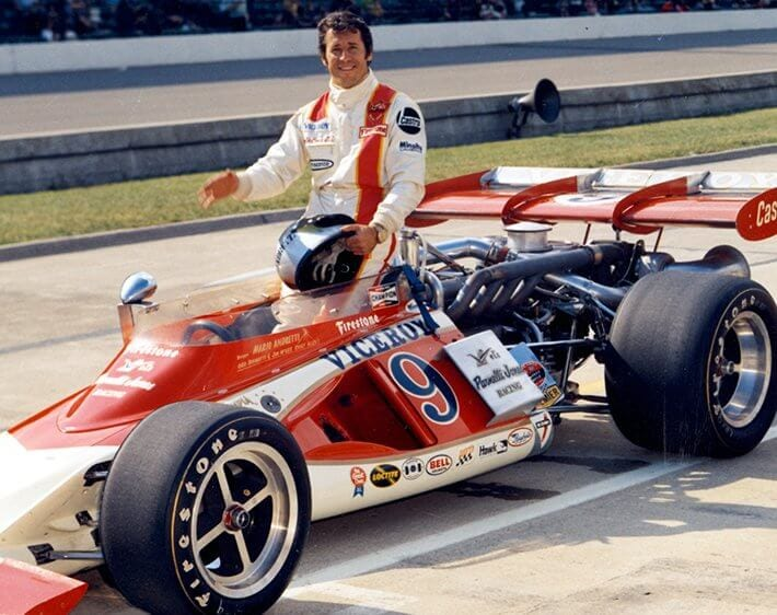 Mario Andretti with race car at the Indianapolis Speedway in 1972
