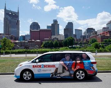 back2school van parked in front of downtown nashville backdrop