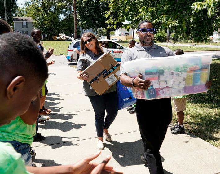 bridgestone team members delivering school supplies