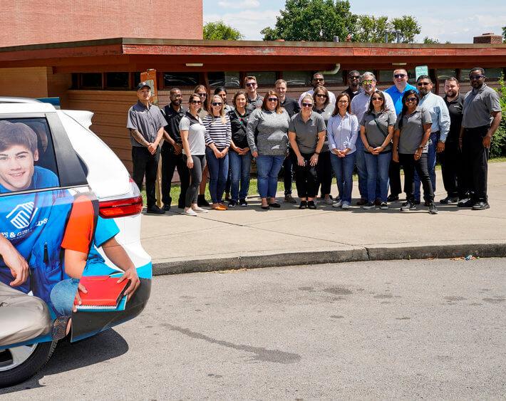 bridgestone team standing behind back2school van