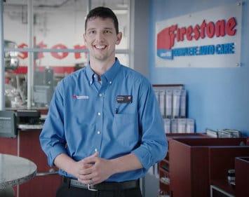 Firestone technician Nick standing in a Firestone office