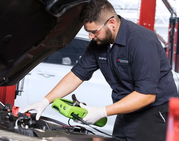 Free car battery test being performed at Firestone Complete Auto Care store