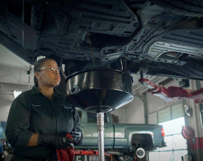 Firestone technician Debra changing oil