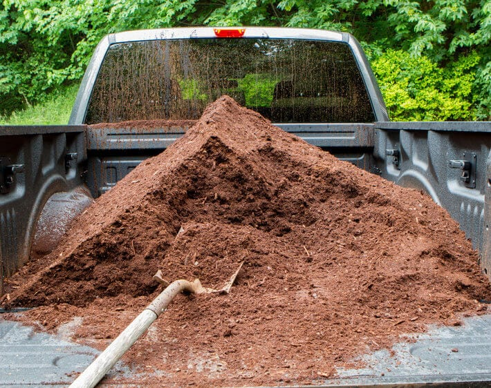 mulch in the bed of a truck