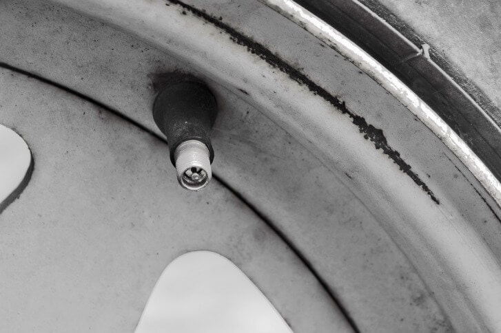 exposed air valve stem of a tire
