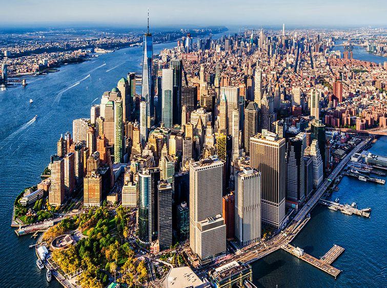 Aerial view of Manhattan Island with NYC skyline