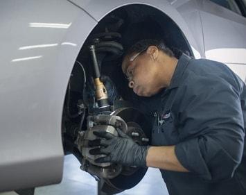 Firestone tech Debra checks brake components