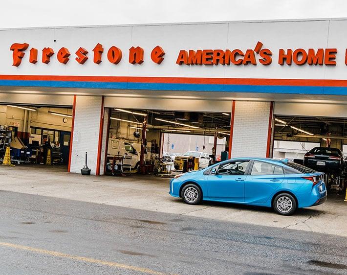 blue car sitting outside Firestone Complete Auto Care