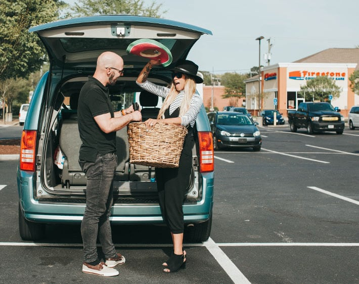 couple cleaning out their car