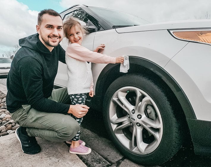 daughter helping her dad clean the car