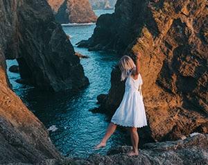 Blogger Alizah walking along the rocky West Coast