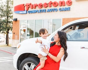 guest blogger Annie with her child in front of Firestone Complete Auto Care