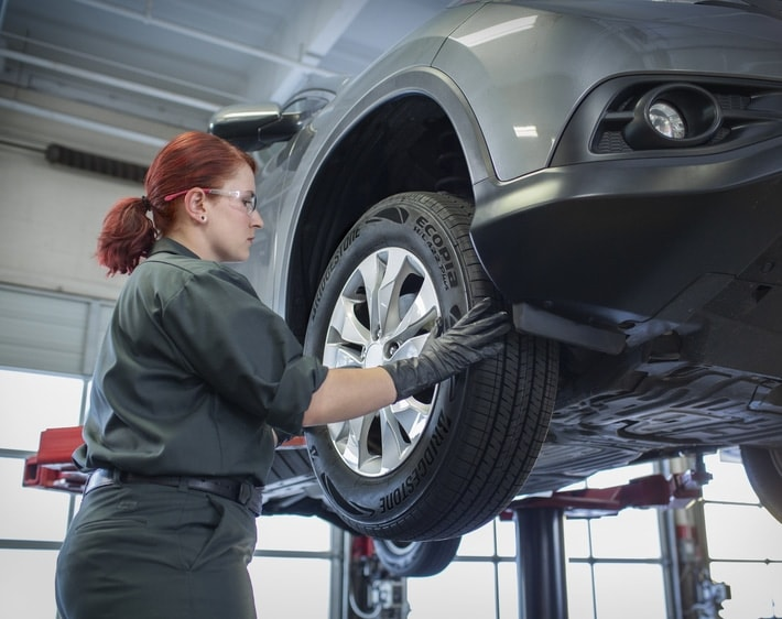 Woman working on a tire