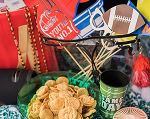 Table of football party snacks and decorations