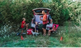 Family tailgating out of SUV