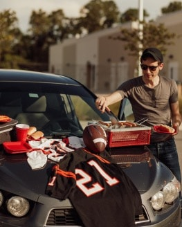 Tailgate supplies on hood of car
