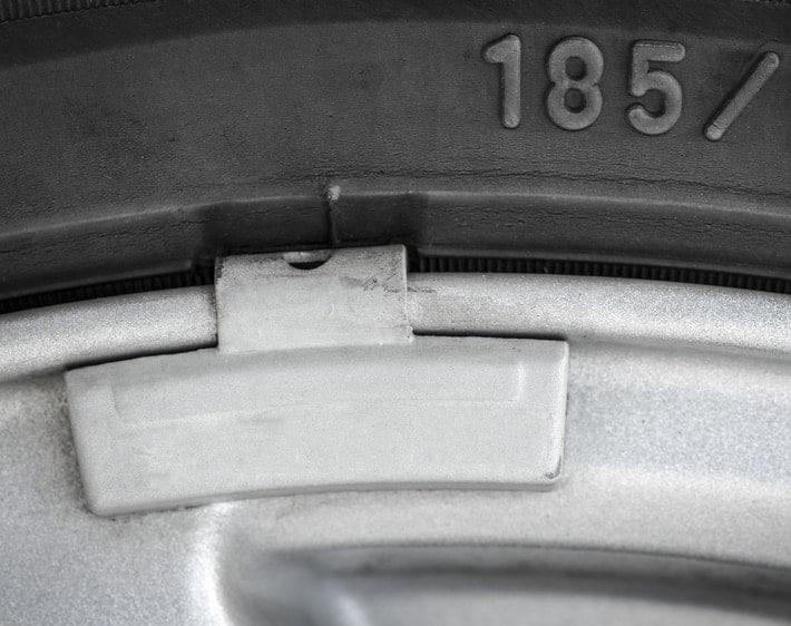 Close-up of tire balancing