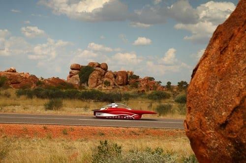 Red solar car in the desert