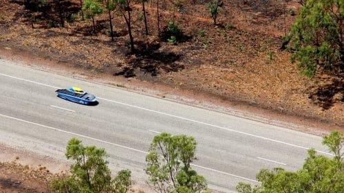 Blue solar car on the highway