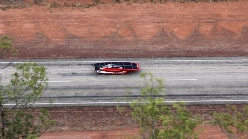 Red solar car on the highway