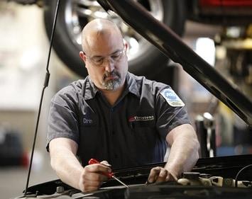 Darin working on a vehicle engine