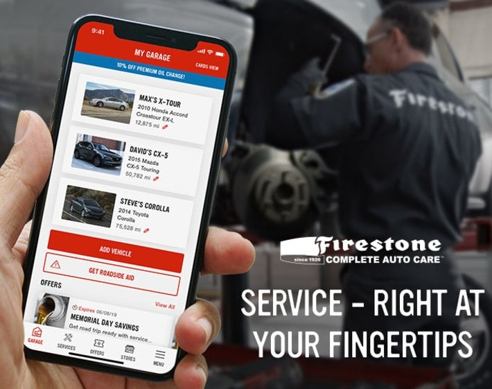 Person holding phone with the Firestone Complete Auto Care mobile app