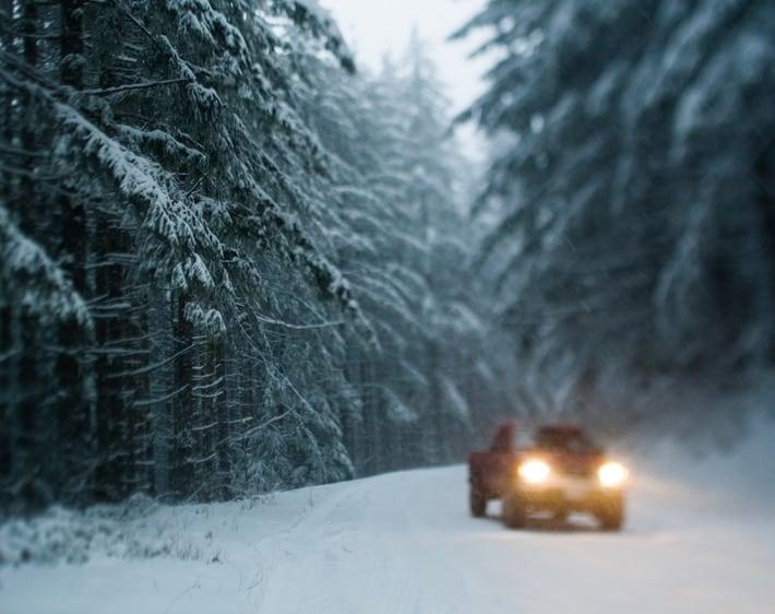 Truck driving through a snow storm
