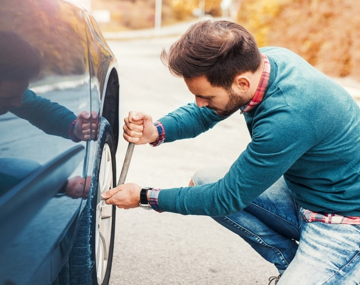 Man changing a flat tire