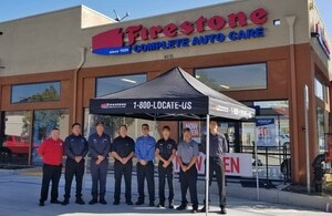 Firestone Complete Auto Care crew standing in front of store