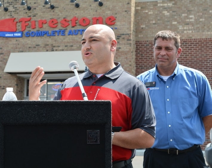 Firestone Complete Auto Care team member giving a speech