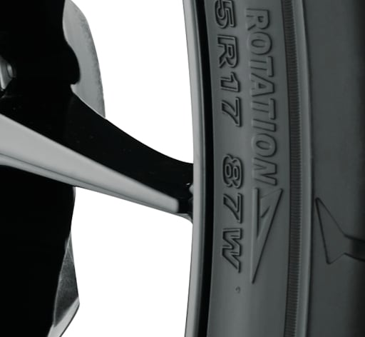 Directional tire sidewall