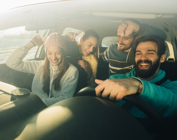 Friends laughing in a car