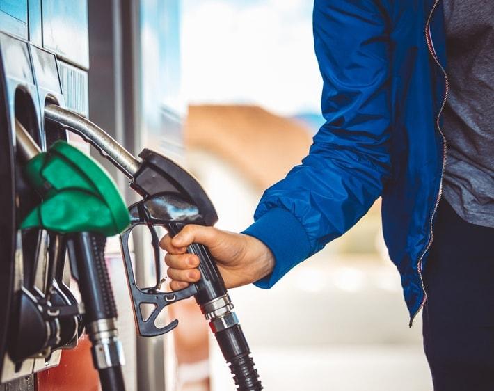 Person grabbing gas pump handle
