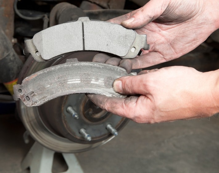 comparison of new and worn brake pads