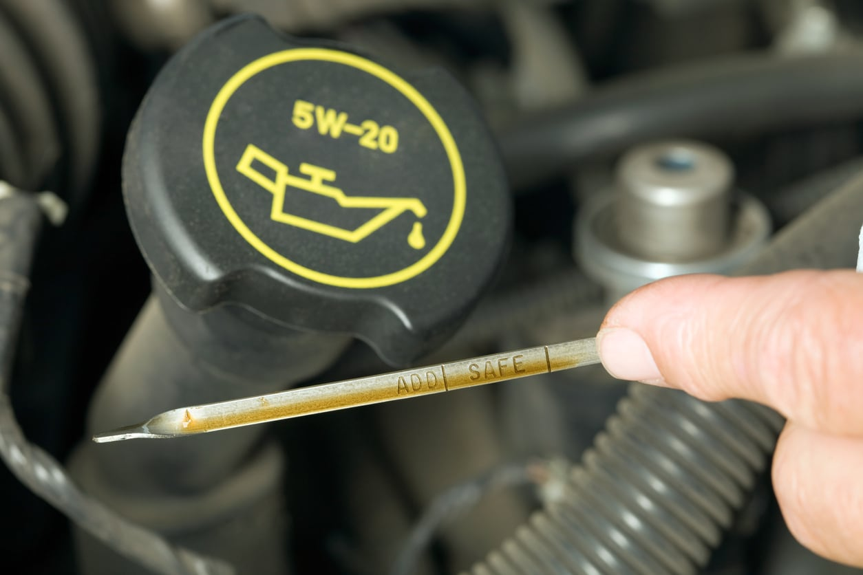image of a dipstick measuring oil
