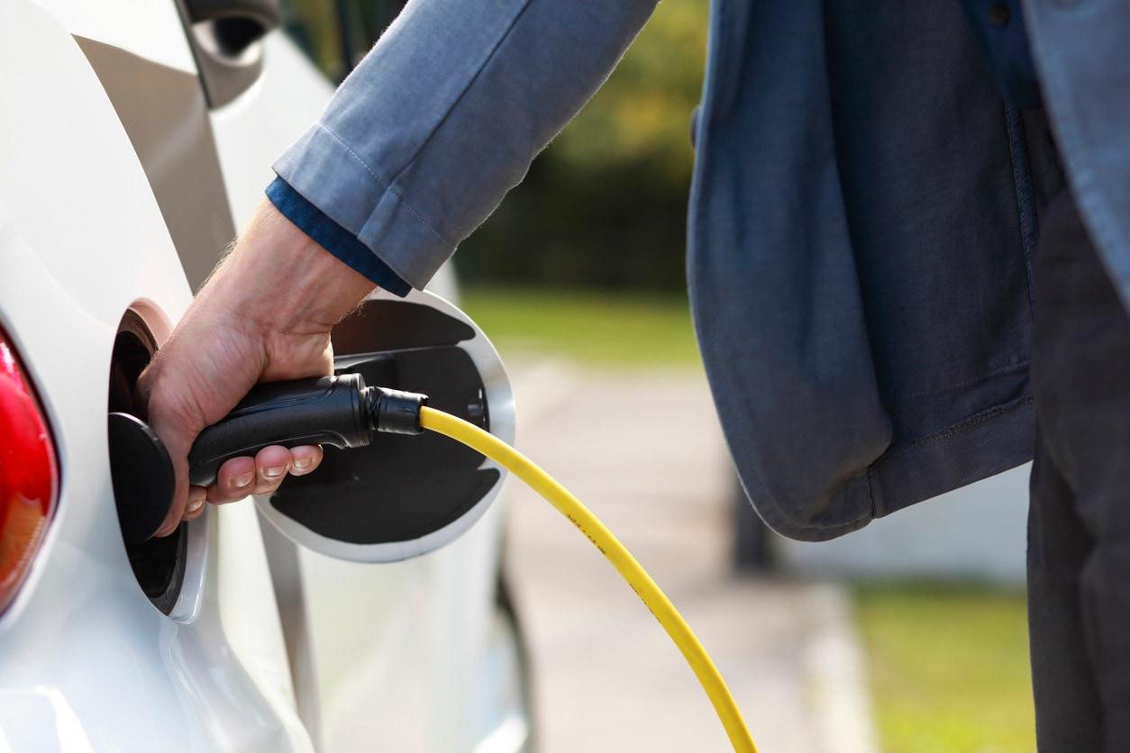 image of man filling up gas tank