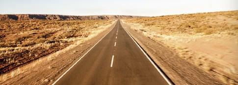 Wide shot of an empty desert road