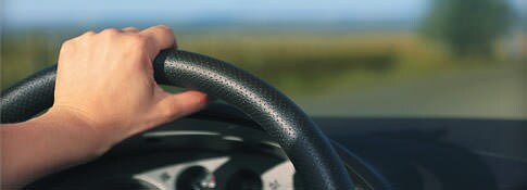 Person's hand on the steering wheel